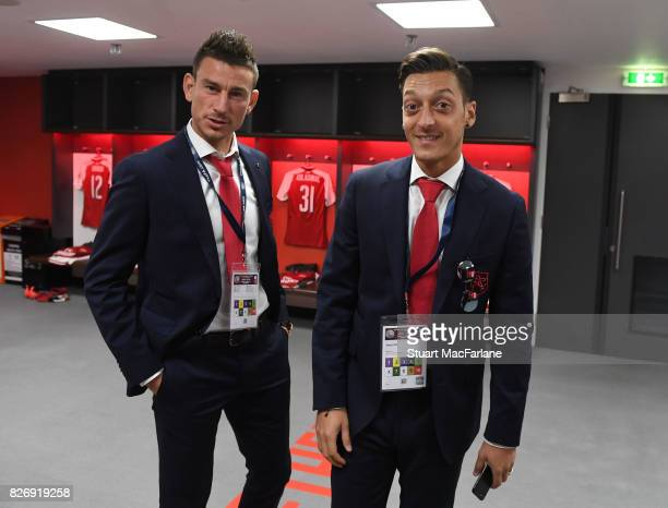 Laurent Koscielny and Mesut Ozil in the Arsenal changing room before the FA Community Shield match between Chelsea and Arsenal at Wembley Stadium on...
