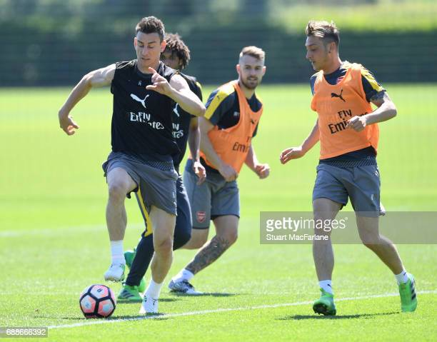 Laurent Koscielny and Mesut Ozil of Arsenal during a training session at London Colney on May 26 2017 in St Albans England