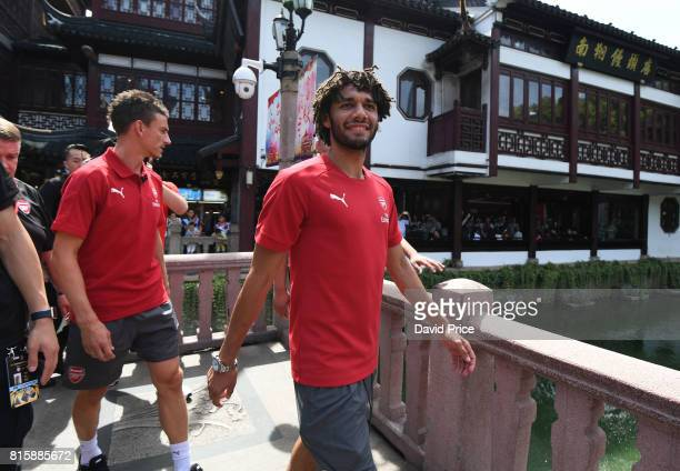 Laurent Koscielny and Mohamed Elneny of Arsenal walk through Yuyuan Gardens on July 17 2017 in Shanghai China