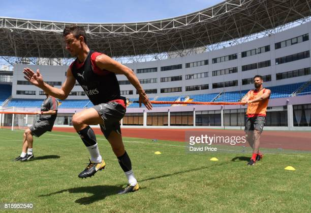 Laurent Koscielny and Olivier Giroud of Arsenal during an Arsenal Training Session at Yuanshen Sports Centre Stadium on July 17 2017 in Shanghai China