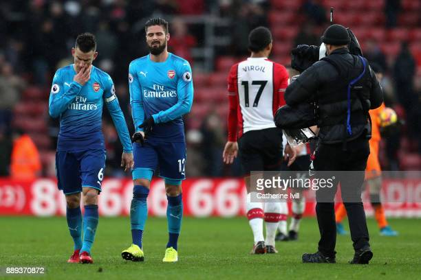 Laurent Koscielny and Olivier Giroud of Arsenal leave the pitch following the Premier League match between Southampton and Arsenal at St Mary's...