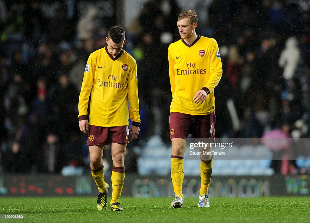 <a gi-track='captionPersonalityLinkClicked' href=/galleries/search?phrase=Laurent+Koscielny&family=editorial&specificpeople=2637418 ng-click='$event.stopPropagation()'>Laurent Koscielny</a> and <a gi-track='captionPersonalityLinkClicked' href=/galleries/search?phrase=Per+Mertesacker&family=editorial&specificpeople=207135 ng-click='$event.stopPropagation()'>Per Mertesacker</a> of Arsenal after the Barclays Premier League match between Aston Villa and Arsenal at Villa Park on November 24, 2012 in Birmingham, England.
