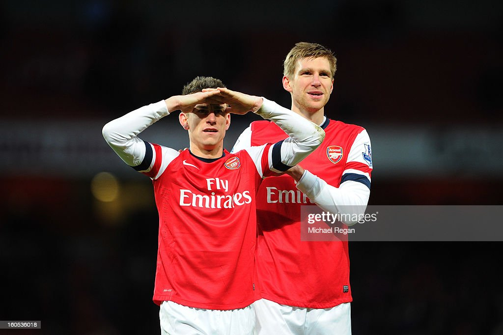 Laurent Koscielny and Per Mertesacker of Arsenal celebrate defeating Stoke City after the Barclays Premier League match between Arsenal and Stoke City at Emirates Stadium on February 2, 2013 in London, England.