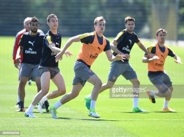 Laurent Koscielny and Rob Holding of Arsenal during a training session at London Colney on May 26 2017 in St Albans England