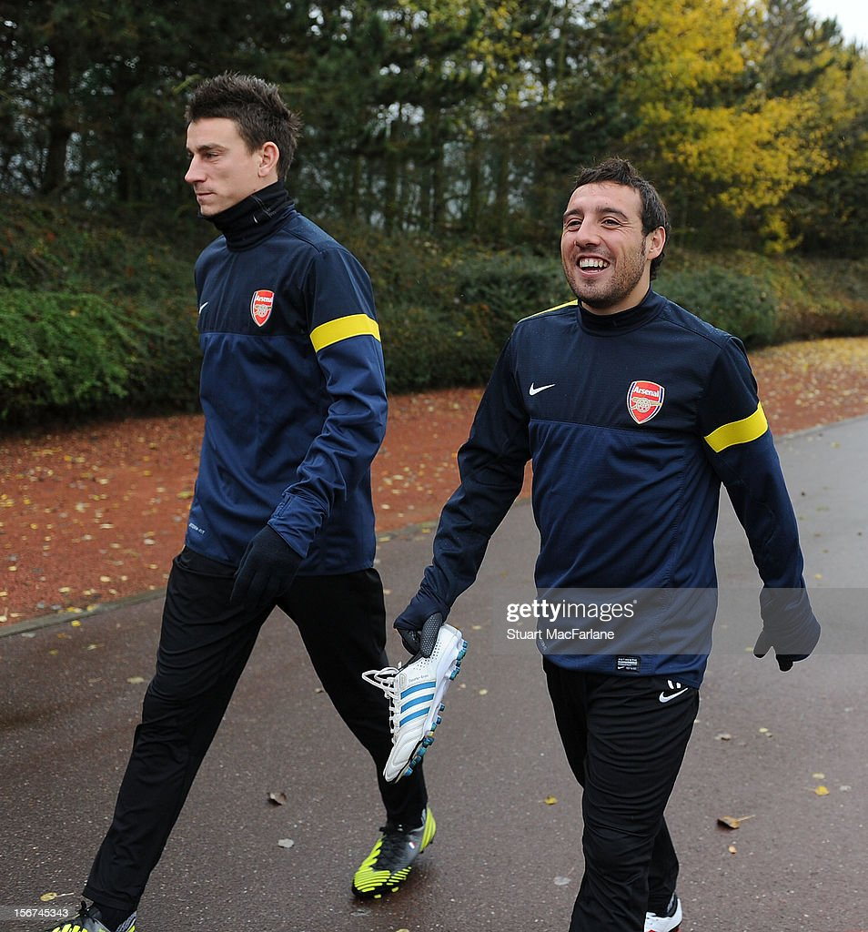 Laurent Koscielny and Santi Cazorla of Arsenal before a training session at London Colney on November 20, 2012 in St Albans, England.