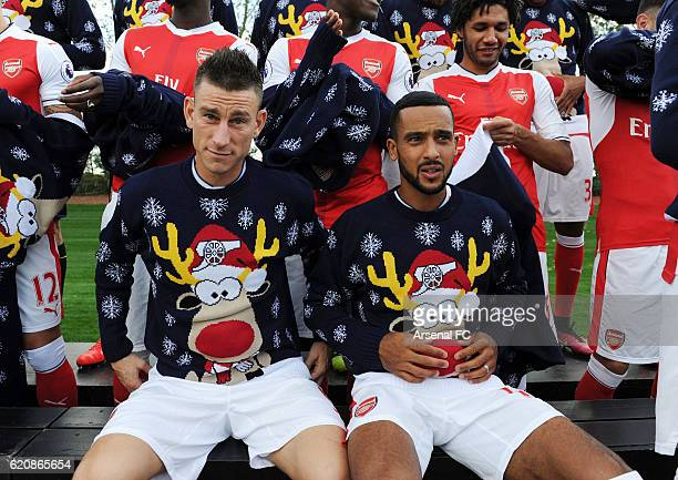 Laurent Koscielny and Theo Walcott of Arsenal in their Christmas Jumpers to support Save the Children Christmas Jumper Day at London Colney on...