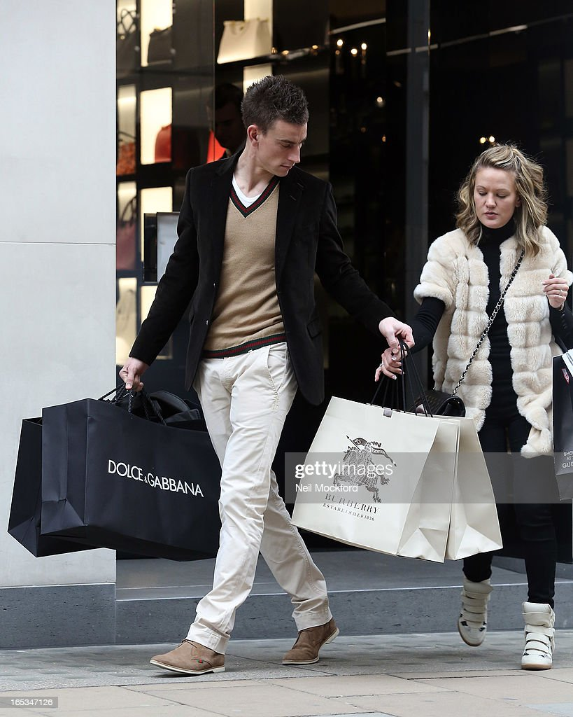 Laurent Koscielny and wife Claire Koscielny seen shopping at Dolce & Gabbana on Old Bond St on April 3, 2013 in London, England.