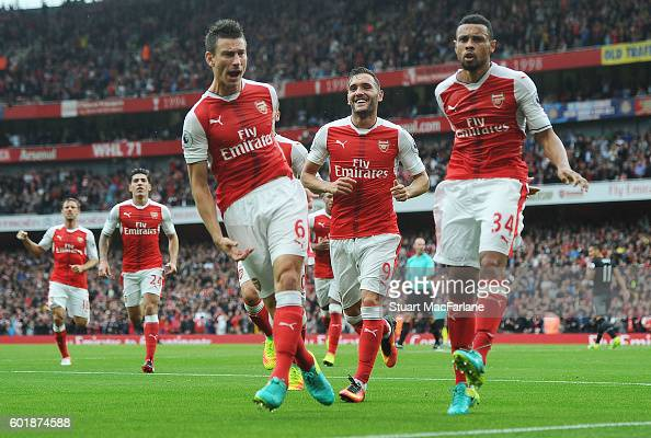 Laurent Koscielny celebrates his goal with Francis Coquelin during the Premier League match between Arsenal and Southampton at Emirates Stadium on...