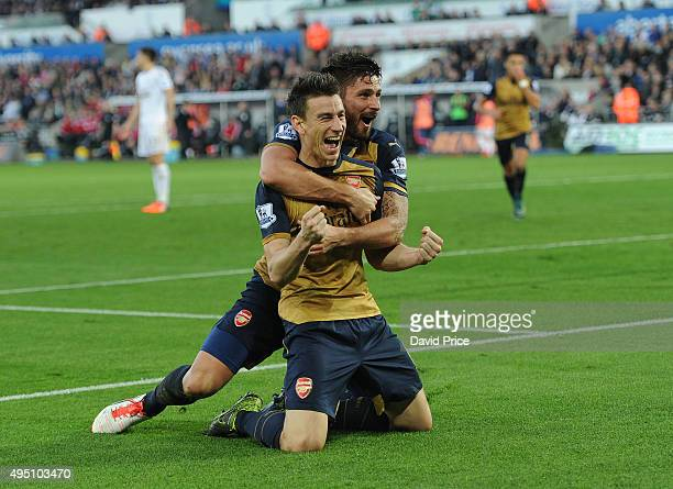 Laurent Koscielny celebrates scoring Arsenal's 2nd goal with Olivier Giroud during the Barclays Premier League match between Swansea City and Arsenal...