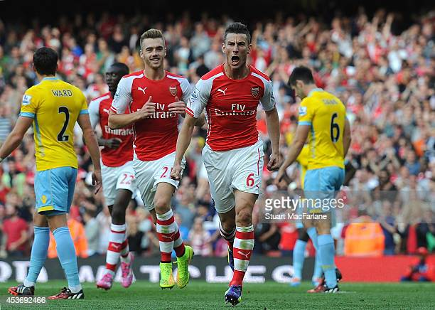 Laurent Koscielny celebrates scoring for Arsenal with teammate Calum Chambers during the Barclays Premier League match between Arsenal and Crystal...