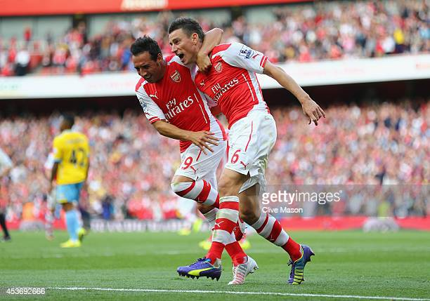 Laurent Koscielny f Arsenal celebrates his goal during the Barclays Premier League match between Arsenal and Crystal Palace at Emirates Stadium on...