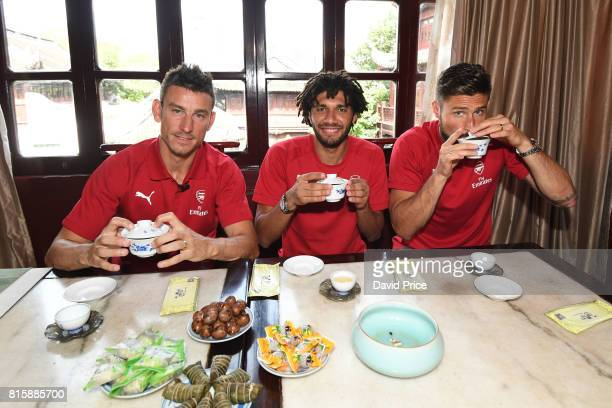 Laurent Koscielny Mohamed Elneny and Olivier Giroud of Arsenal experience a Chinese Tea Ceremony at LvBo Lang Restaurant in Yuyuan Gardens on July 17...