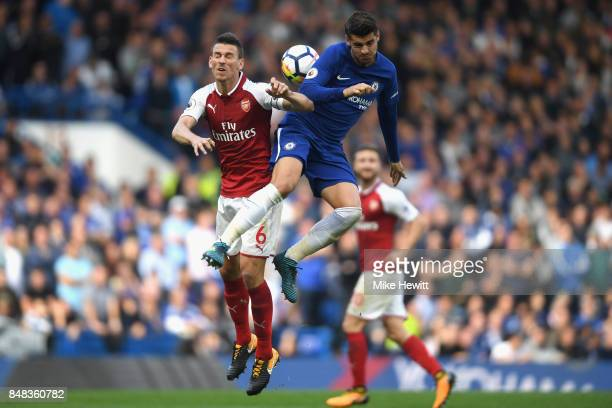 Laurent Koscielny of Arsenal and Alvaro Morata of Chelsea battle for possession in the air during the Premier League match between Chelsea and...
