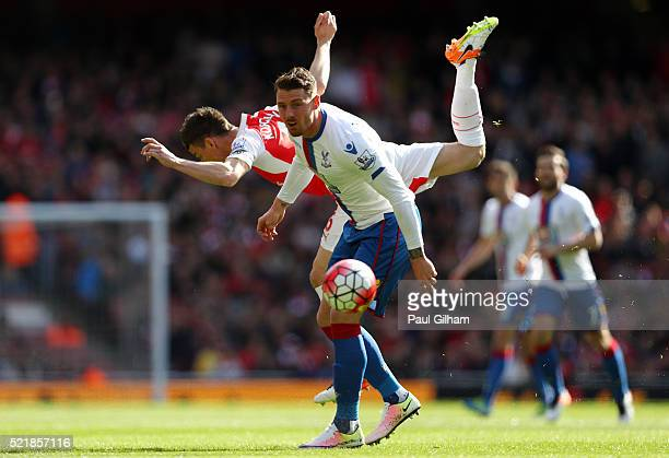 Laurent Koscielny of Arsenal and Connor Wickham of Crystal Palace battle for an aerial ball during the Barclays Premier League match between Arsenal...