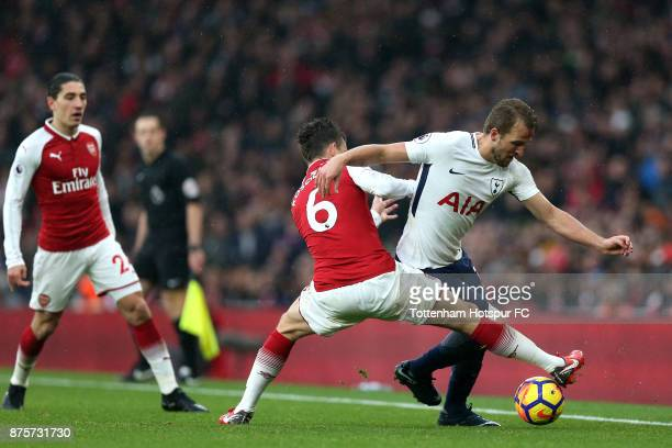 Laurent Koscielny of Arsenal and Harry Kane of Tottenham Hotspur battle for possession during the Premier League match between Arsenal and Tottenham...