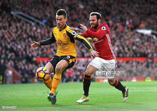 Laurent Koscielny of Arsenal and Juan Mata of Manchester United battle for possession during the Premier League match between Manchester United and...