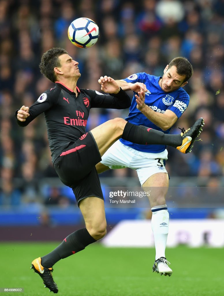 Laurent Koscielny of Arsenal and Leighton Baines of Everton battle for possession during the Premier League match between Everton and Arsenal at Goodison Park on October 22, 2017 in Liverpool, England.
