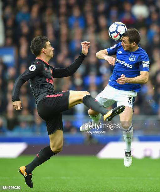 Laurent Koscielny of Arsenal and Leighton Baines of Everton battle for possession during the Premier League match between Everton and Arsenal at...