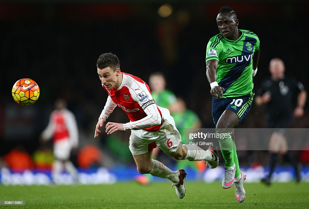 Laurent Koscielny of Arsenal and Sadio Mane of Southampton compete for the ball during the Barclays Premier League match between Arsenal and Southampton at the Emirates Stadium on February 2, 2016 in London, England.