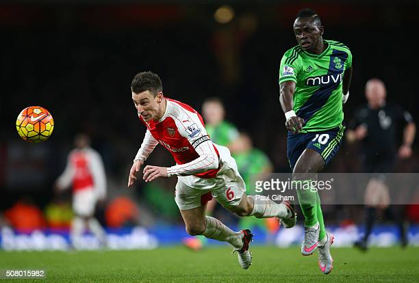 Laurent Koscielny of Arsenal and Sadio Mane of Southampton compete for the ball during the Barclays Premier League match between Arsenal and...