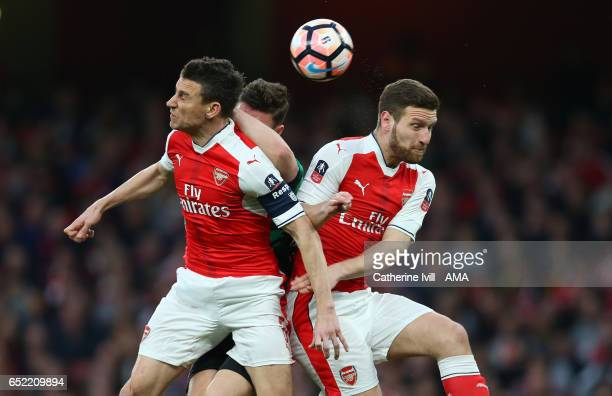 Laurent Koscielny of Arsenal and Shkodran Mustafi of Arsenal during The Emirates FA Cup QuarterFinal match between Arsenal and Lincoln City at...