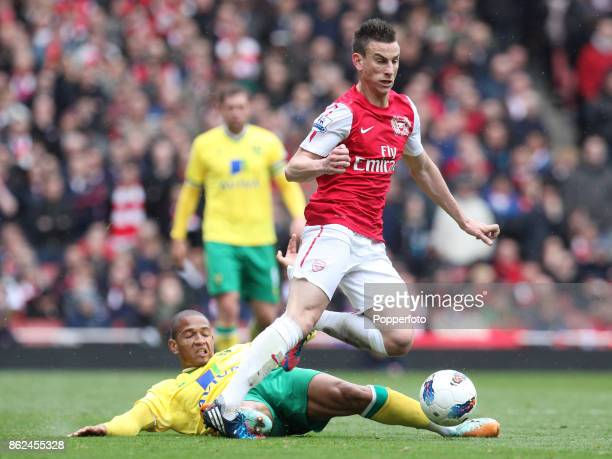 Laurent Koscielny of Arsenal and Simeon Jackson of Norwich City in action during the Barclays Premier League match between Arsenal and Norwich City...