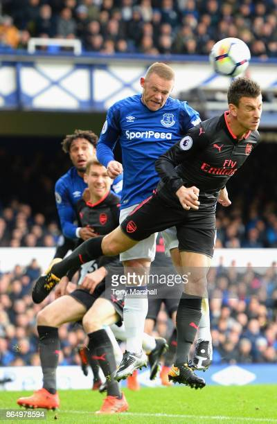 Laurent Koscielny of Arsenal and Wayne Rooney of Everton during the Premier League match between Everton and Arsenal at Goodison Park on October 22...