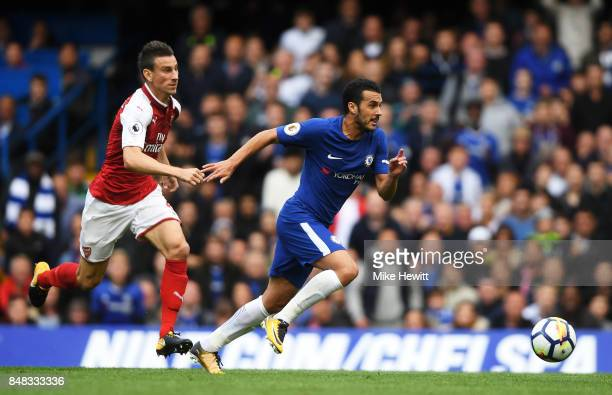 Laurent Koscielny of Arsenal attempts to keep up with Pedro of Chelsea during the Premier League match between Chelsea and Arsenal at Stamford Bridge...