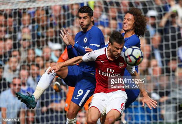 Laurent Koscielny of Arsenal battles it out with Alvaro Morata and David Luiz of Chelsea during the Premier League match between Chelsea and Arsenal...