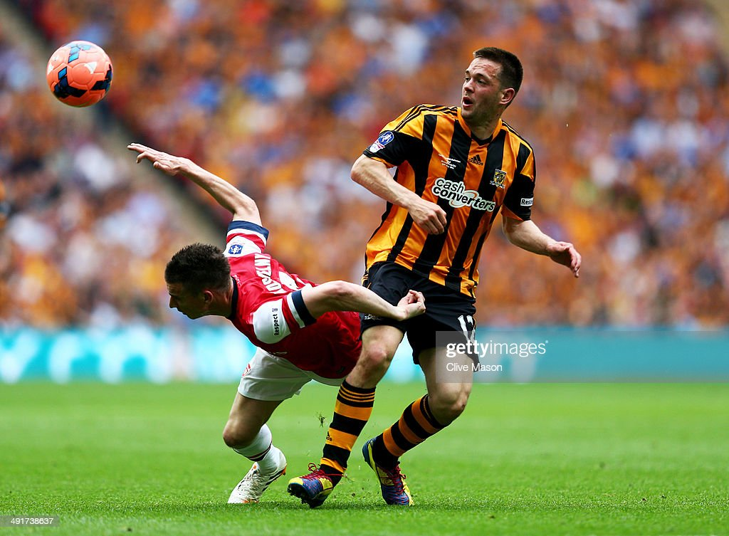 Laurent Koscielny of Arsenal battles with Matthew Fryatt of Hull City during the FA Cup with Budweiser Final match between Arsenal and Hull City at Wembley Stadium on May 17, 2014 in London, England.