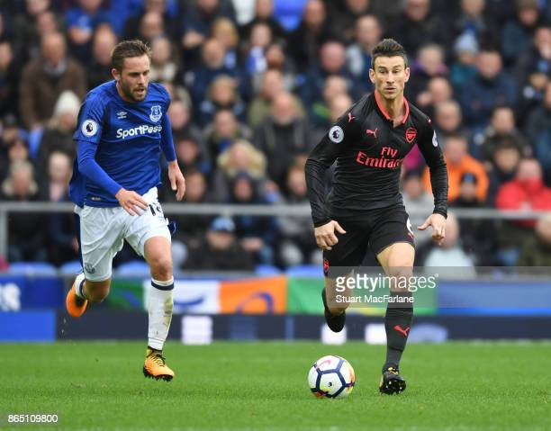 Laurent Koscielny of Arsenal breaks past Gylfi Sigurdsson of Everton during the Premier League match between Everton and Arsenal at Goodison Park on...