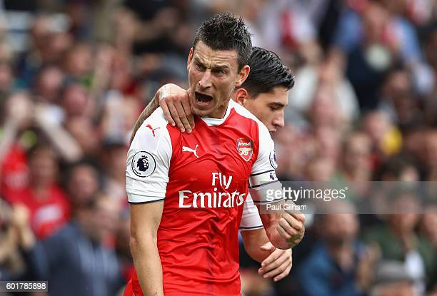 Laurent Koscielny of Arsenal celebrates scoring his sides first goal during the Premier League match between Arsenal and Southampton at Emirates...
