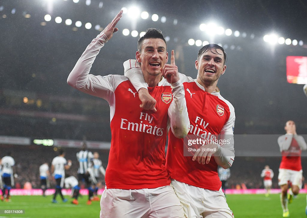 <a gi-track='captionPersonalityLinkClicked' href=/galleries/search?phrase=Laurent+Koscielny&family=editorial&specificpeople=2637418 ng-click='$event.stopPropagation()'>Laurent Koscielny</a> (L) of Arsenal celebrates scoring his team's first goal with his team mate <a gi-track='captionPersonalityLinkClicked' href=/galleries/search?phrase=Aaron+Ramsey&family=editorial&specificpeople=4784114 ng-click='$event.stopPropagation()'>Aaron Ramsey</a> (R) during the Barclays Premier League match between Arsenal and Newcastle United at Emirates Stadium on January 2, 2016 in London, England.