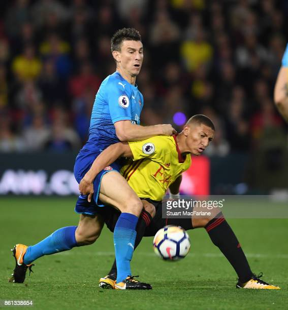 Laurent Koscielny of Arsenal challenges by Richarlison of Watford during the Premier League match between Watford and Arsenal at Vicarage Road on...