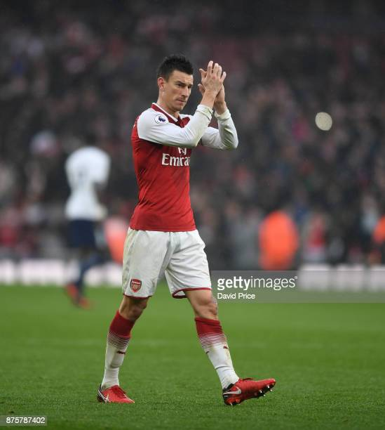 Laurent Koscielny of Arsenal claps the fans after the Premier League match between Arsenal and Tottenham Hotspur at Emirates Stadium on November 18...