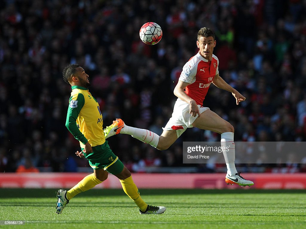 Laurent Koscielny of Arsenal clears the ball away from Nathan Redmond of Norwich during the Barclays Premier League match between Arsenal and Norwich City at on April 30, 2016 in London, England