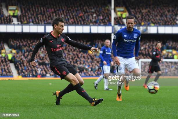 Laurent Koscielny of Arsenal crosses under pressure from Gylfi Sigurdsson of Everton during the Premier League match between Everton and Arsenal at...