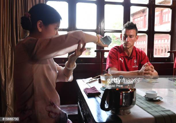 Laurent Koscielny of Arsenal experiences a Chinese Tea Ceremony at LvBo Lang Restaurant in Yuyuan Gardens on July 17 2017 in Shanghai China