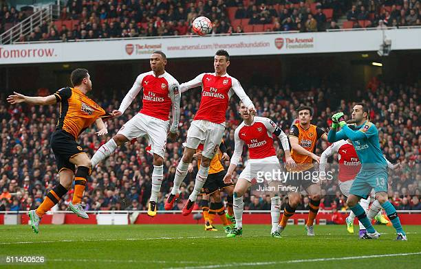 Laurent Koscielny of Arsenal heads the ball during the Emirates FA Cup fifth round match between Arsenal and Hull City at the Emirates Stadium on...
