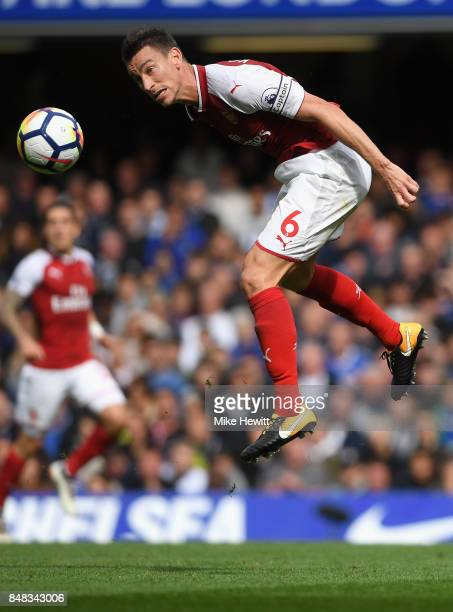 Laurent Koscielny of Arsenal heads the ball during the Premier League match between Chelsea and Arsenal at Stamford Bridge on September 17 2017 in...
