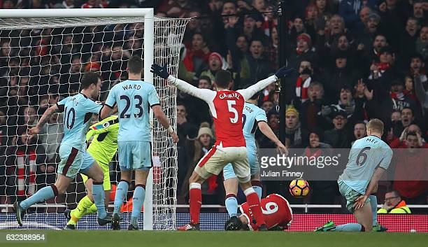 Laurent Koscielny of Arsenal is challenged by Ben Mee of Burnley in the box resulting in a penalty to Arsenal during the Premier League match between...