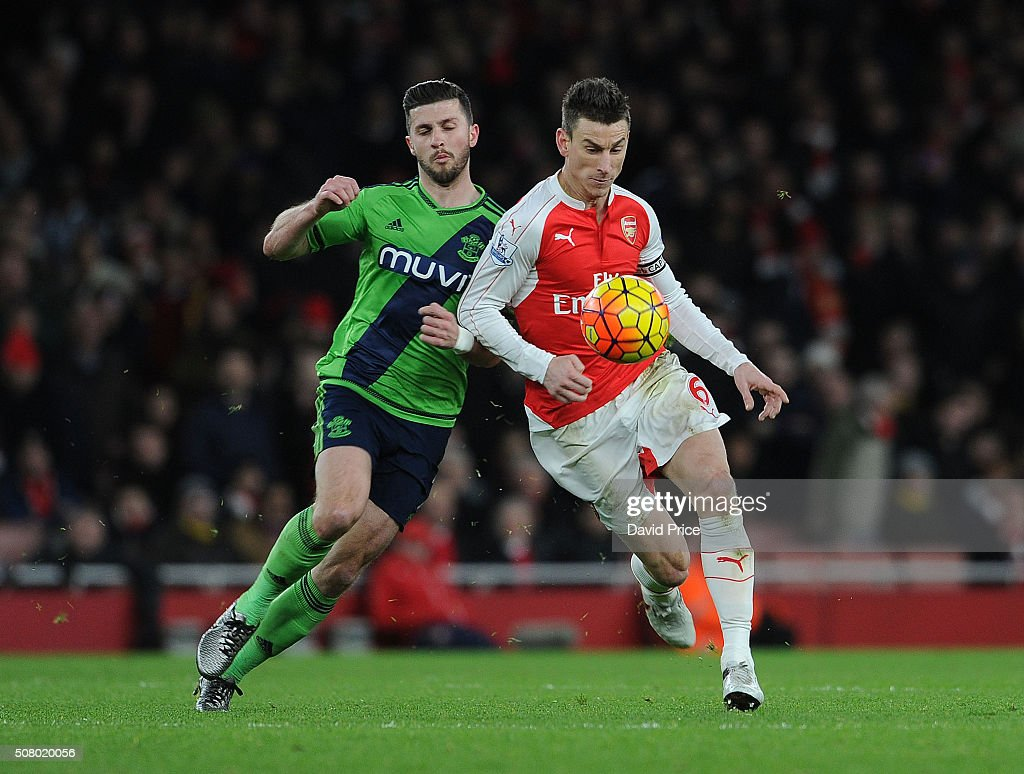Laurent Koscielny of Arsenal is challenged by Shane Long of Southampton during the Barclays Premier League match between Arsenal and Southampton at Emirates Stadium on February 2, 2016 in London, England.