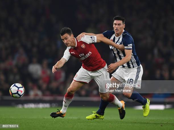 Laurent Koscielny of Arsenal is challenged Gareth Barry of WBA during the Premier League match between Arsenal and West Bromwich Albion at Emirates...