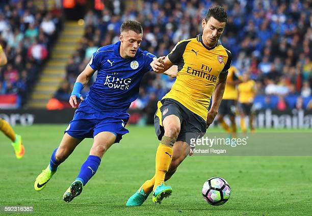 Laurent Koscielny of Arsenal is put under pressure from Jamie Vardy of Leicester City during the Premier League match between Leicester City and...