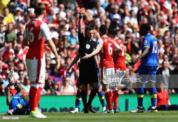 Laurent Koscielny of Arsenal is shown the red card during the Premier League match between Arsenal and Everton at Emirates Stadium on May 21 2017 in...