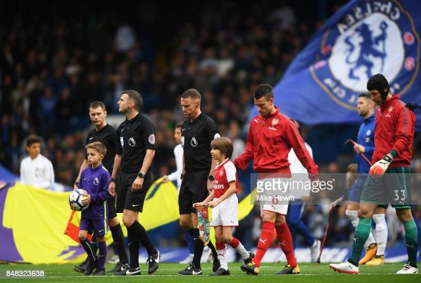 Laurent Koscielny of Arsenal leads his team out prior to the Premier League match between Chelsea and Arsenal at Stamford Bridge on September 17 2017...