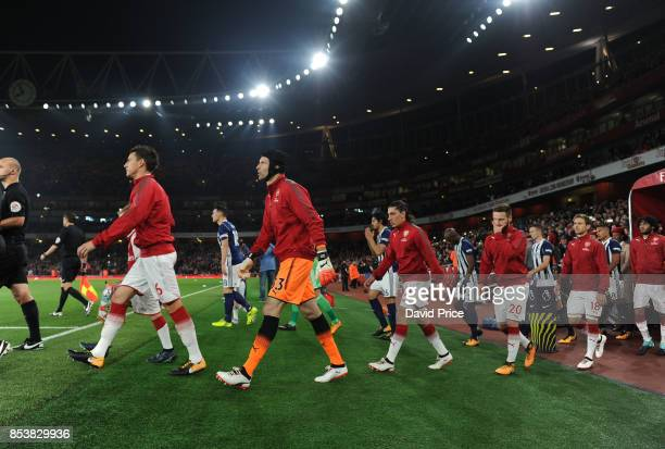 Laurent Koscielny of Arsenal leads out the team before the Premier League match between Arsenal and West Bromwich Albion at Emirates Stadium on...