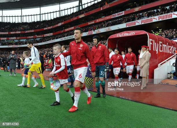 Laurent Koscielny of Arsenal leads the team out before the Premier League match between Arsenal and Tottenham Hotspur at Emirates Stadium on November...