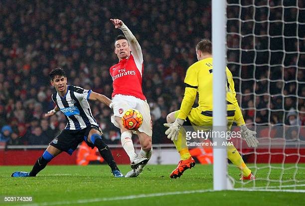 Laurent Koscielny of Arsenal scores a goal to make it 10 during the Barclays Premier League match between Arsenal and Newcastle United at Emirates...