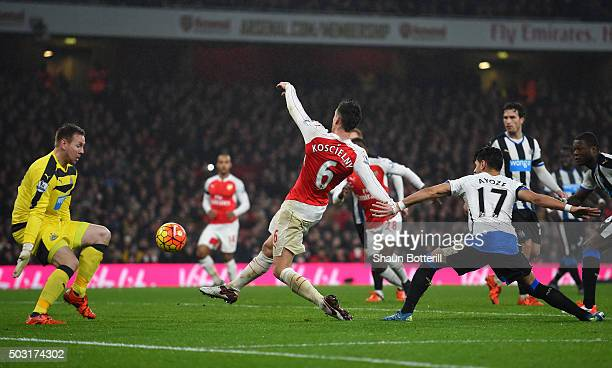 Laurent Koscielny of Arsenal scores his team's first goal past Robert Elliot of Newcastle United during the Barclays Premier League match between...